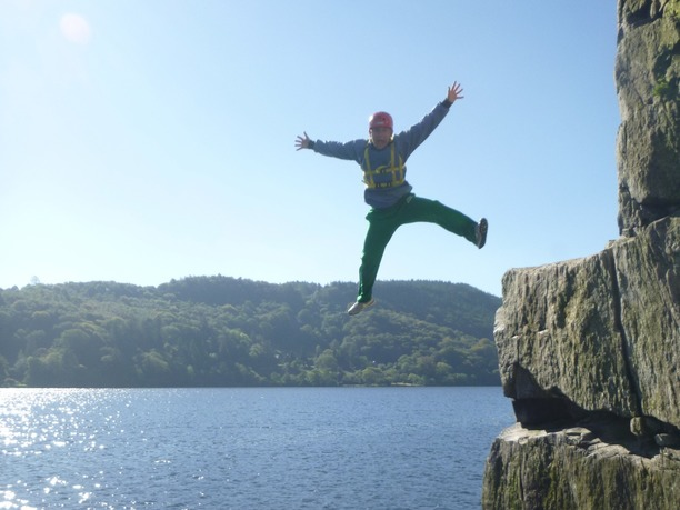 An adult leaping from elephant rock at Llyn Gwynant