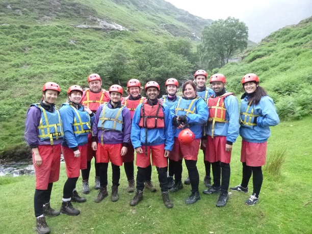 A team of teachers in buoyancy aids, helmets and water proofs